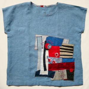 Linen top with appliqué made from recycled fabric